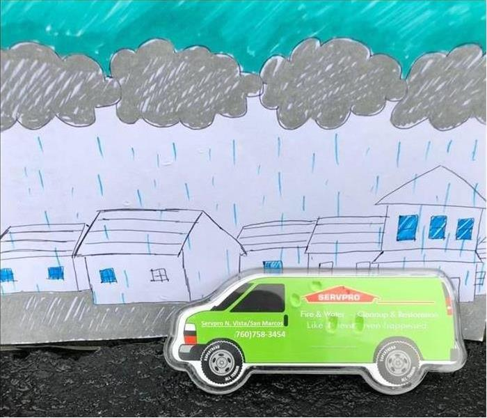 SERVPRO green van driving in pencil drawn storm.